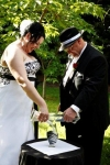 Tanya and Grant - sand ceremony Photo by Blue Fence Events.jpg
